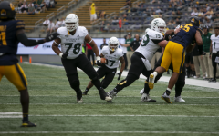 Sac State wide receiver Dewey Cotton (17) looks for a running lane in between his linemen Brandon Weldon (78) and Thomas Parker (79) against Cal in the first half at California Memorial Stadium on Saturday, Sept. 18, 2021. The Hornets fell to the Bears 42-30, dropping their record on the season to 1-2.