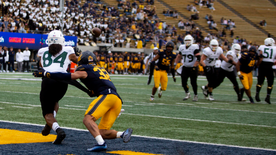 Sac State junior wideout Pierre Willams (84) catches a pass from junior quarterback Jake Dunniway for a touchdown late in the fourth quarter at California Memorial Stadium on Saturday, Sept. 18, 2021. The Hornets fell to the Bears 42-30, dropping their record on the season to 1-2.