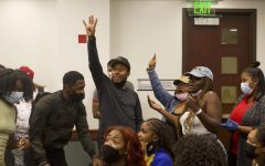 """Khalil Ferguson, one the founding members of BSU and current president of the Black Alumni Chapter, and his group after participating in the singing game Encore on Thursday, Sept. 16, 2021. """"Welcome Black"""" attendees played Encore to open the event."""