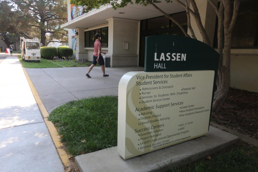 The Services for Students with Disabilities (SSWD) office is located in Lassen Hall with students entering and exiting. SSWD has set up a computer lab where staff are helping disabled students familiarize with the new Clockwork program for the SSWD Portal — no longer needing their all-paper format.