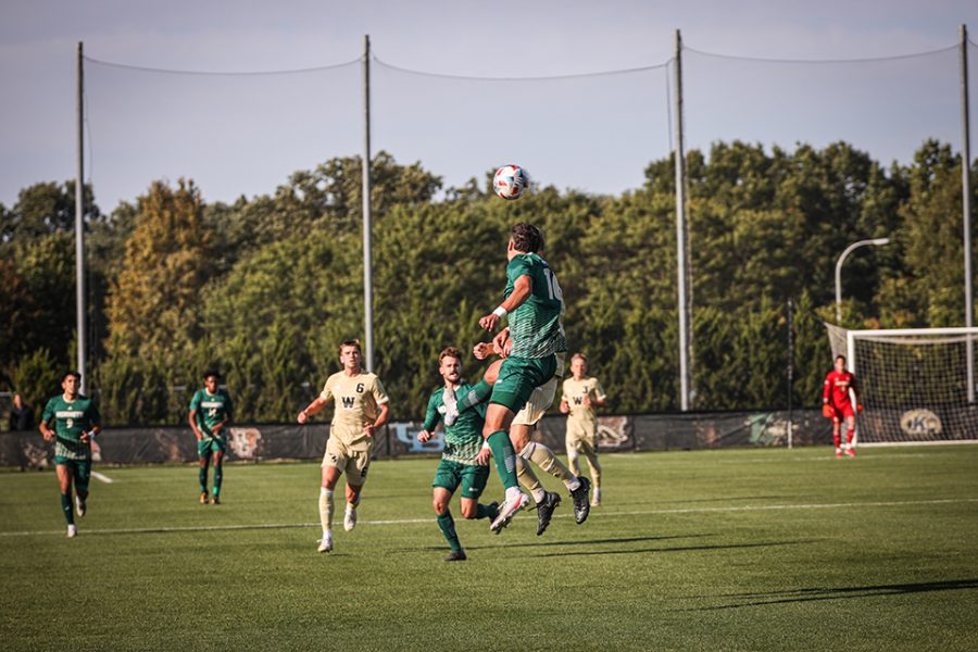 Freshman defender Alejandro Padilla heads the ball against the Broncos on Sept. 24, 2021 at the WMU Soccer Complex. The Hornets have allowed one goal or fewer in four straight matches.