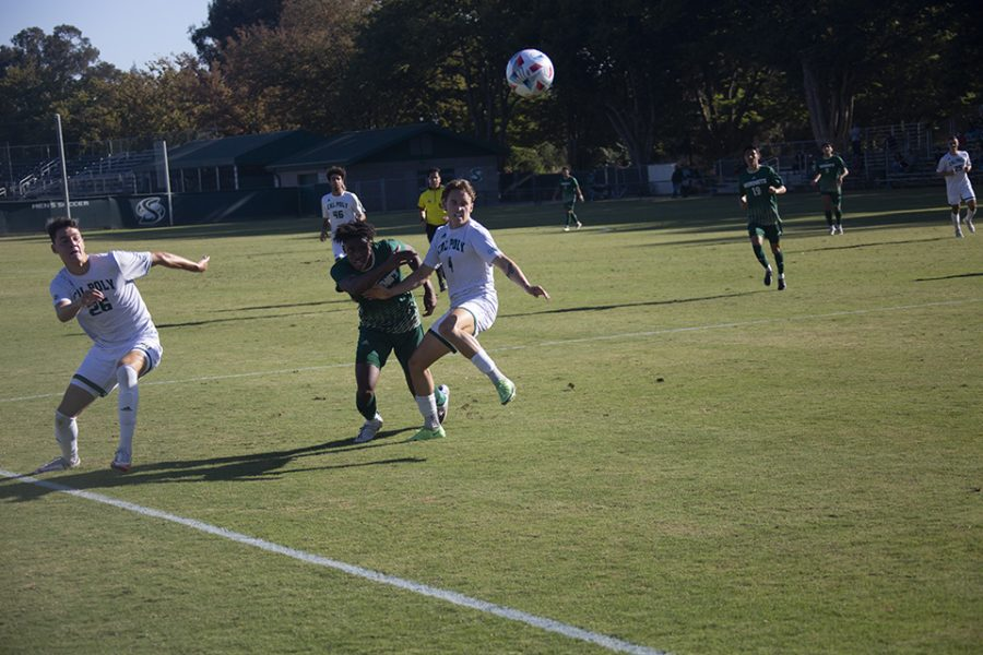 Hornets sophomore forward Titus Washington wrestles past a Cal Poly defender in pursuit of the ball Sept. 29, 2021 in a 1-1 tie at Hornet Field. The Hornets home record is now 0-3-1 on the season.