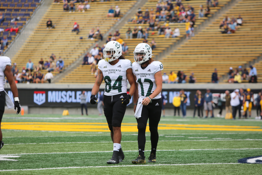 Junior quarterback Jake Dunniway (12) and junior wide receiver Pierre Willams (84) stand side by side walking off the field at California Memorial Stadium on Sept.18, 2021. The Hornets pulled out a slim 23-21 victory in their game against Idaho State on Saturday.