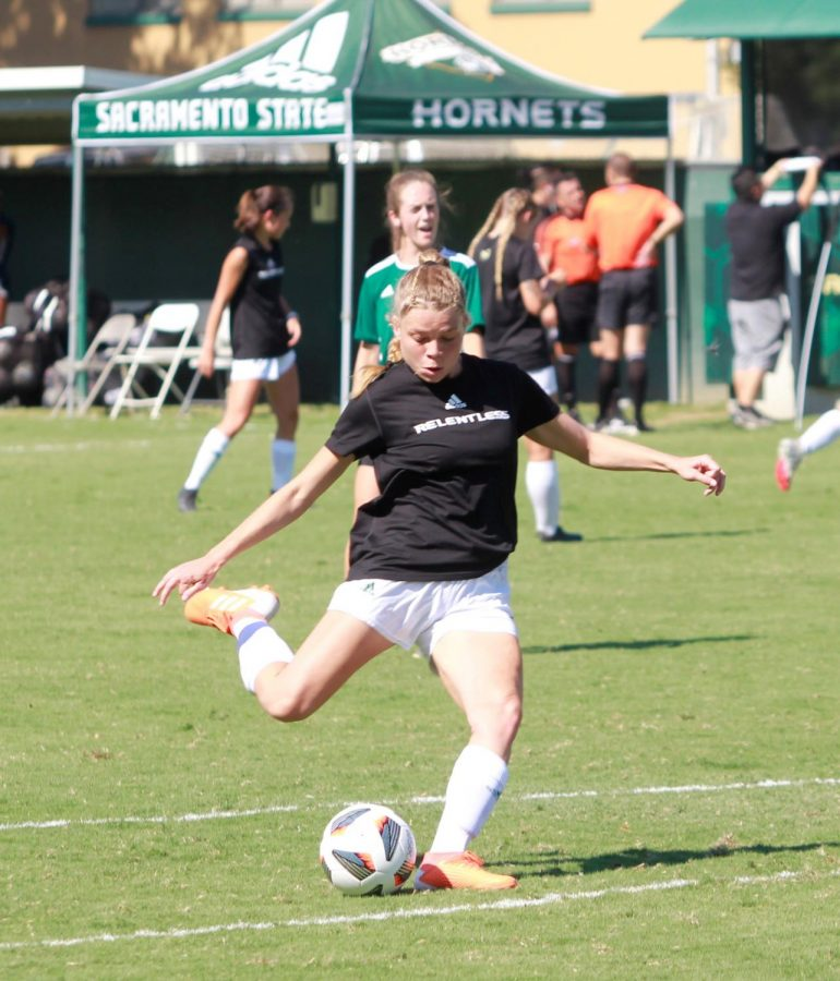 Sophomore forward Jasmyne Dunn takes a practice shot in warm-ups before Sac States match against Nevada at Hornet Field on Sunday, Sept. 5, 2021. The Hornets and Bulldogs game on Sunday, Sept. 19 ended in a 1-1 draw as Sac State came off back-to-back losses in the last two weeks.