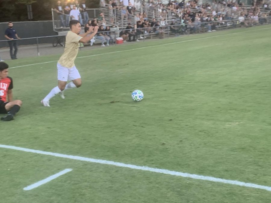 Sophomore forward Christo Cervantes drops a University of Nevada, Las Vegas defender as he dribbles the ball in a match on Friday, Sept. 10, 2021. Cervantes had two shots on goal in Monday night's loss 1-0 loss to University of Portland.