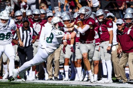 Sac State freshman linebacker Mitchell Wolfe (58) gets stiff-armed as he attempts to tackle Montana sophomore safety Garrett Graves (5) on Oct. 16, 2021, at Washington-Grizzly Stadium. The Hornets pulled off the upset and beat the #5 ranked Grizzlies for the first time in Missoula by a score of 28-21.