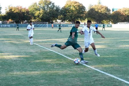 Sacramento State sophomore forward Christo Cervantes (left) shoots while UC San Diego sophomore defender Adam Walker (right) defends during a soccer game on Oct. 16, 2021, at Hornet Field. Sac State won the game 2-1 and will now stay in the postseason race for the Big West tournament, according to head coach Michael Linenberger.