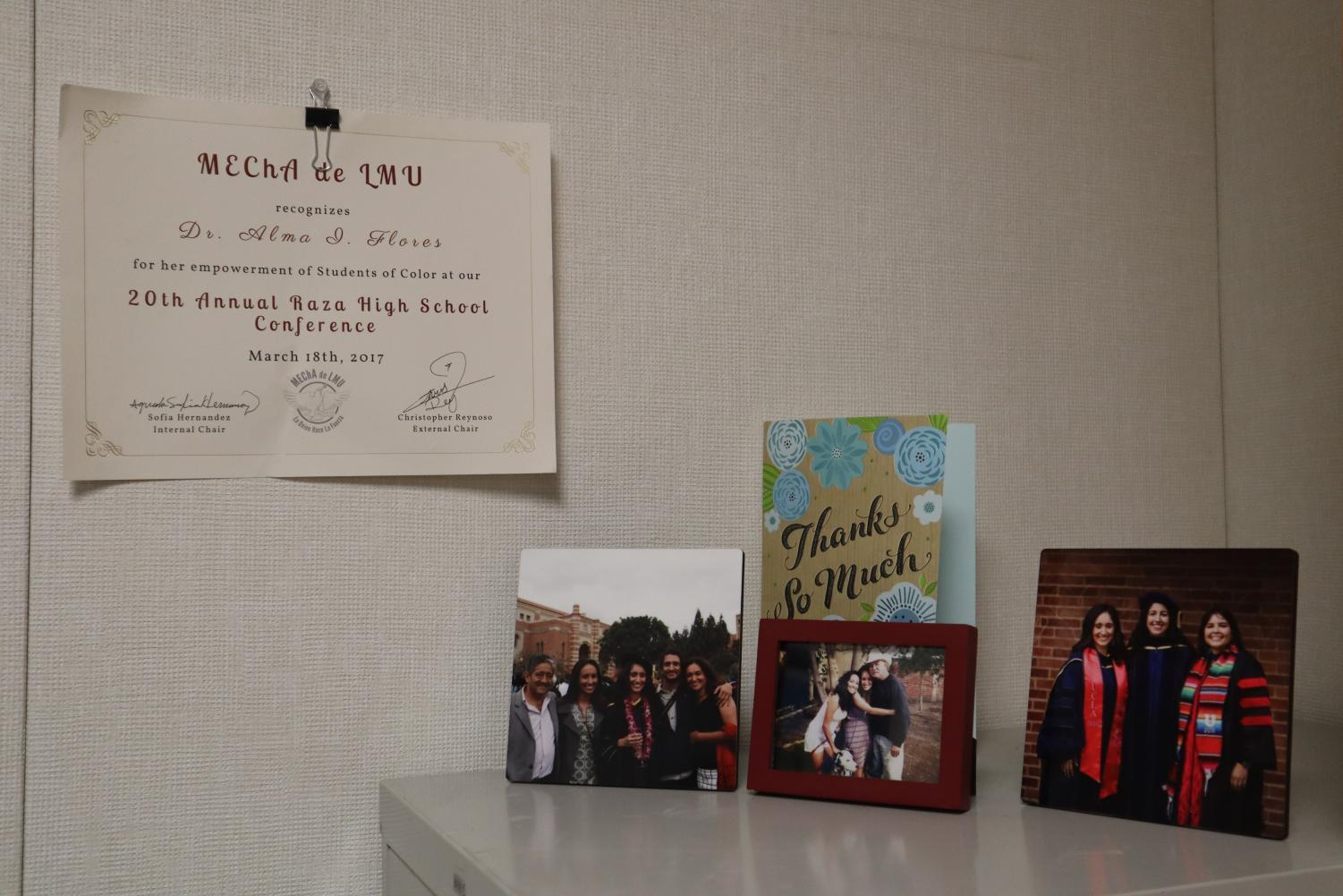 Sacramento State's education assistant professor Alma Flores hangs an award from Loyola Marymount University's Movimiento Estudiantil Chicanx de Aztlán that recognizes her for her empowerment of students of color. Flores said that not only does Sac State need to hire more faculty of color, but the retention of that faculty is just as important.