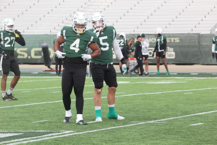Senior linebacker Taylor Powell (4) and senior linebacker Marcus Hawkins (5) communicate in between plays on Oct. 19, 2021, at Hornet Stadium. Hawkins and Powell have combined for 82 total tackles on the season.