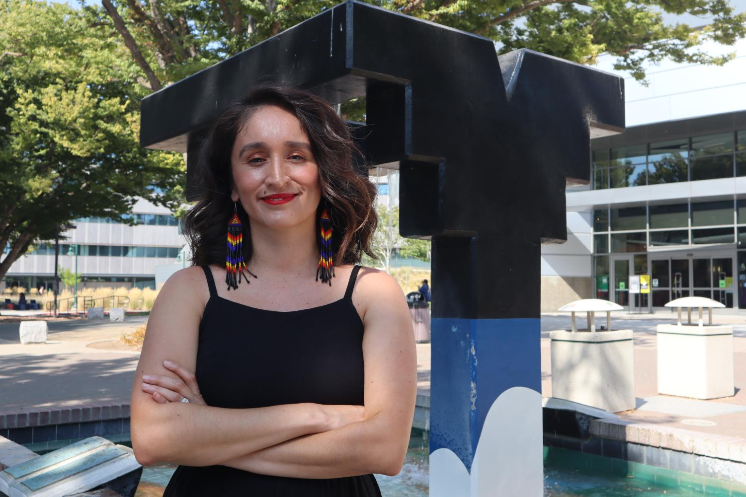 """Sacramento State education assistant professor Alma Flores stands by the Serna Fountain on Sept. 7, 2021. Flores said she had romanticized the CSU because demographically their students were diverse and thought the faculty would be somewhat diverse, but it was """"very white."""""""
