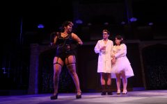 """J.J. Jones (left), Phoenix Brewer (middle), and Avery Hersek (right) rehearsing the song """"Sweet Transvestite"""" in the University Theatre on Oct. 15. The Rocky Horror Show opens Wednesday and runs until Oct. 31."""