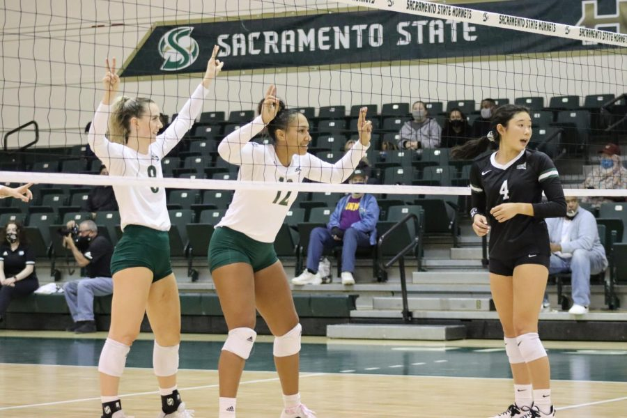 Sac State volleyball sophomores, outside hitter Bridgette Smith (8) and middle blocker Kalani Hayes (12), face off against Portland State's senior setter Ally Wada (4) at the net on Oct. 19, 2021. The Hornets won in three sets and broke Portland State's seven-game win streak.