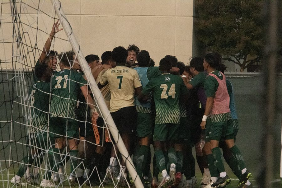 Sacramento State's men's soccer team celebrates the final goal of the game scored by sophomore forward Christo Cervantes at Hornet Field on Saturday, Oct. 2, 2021. Sac State secured a 3-2 victory against UC Irvine for the first home win of the season during the Sac State men's soccer program's 50th anniversary celebration.