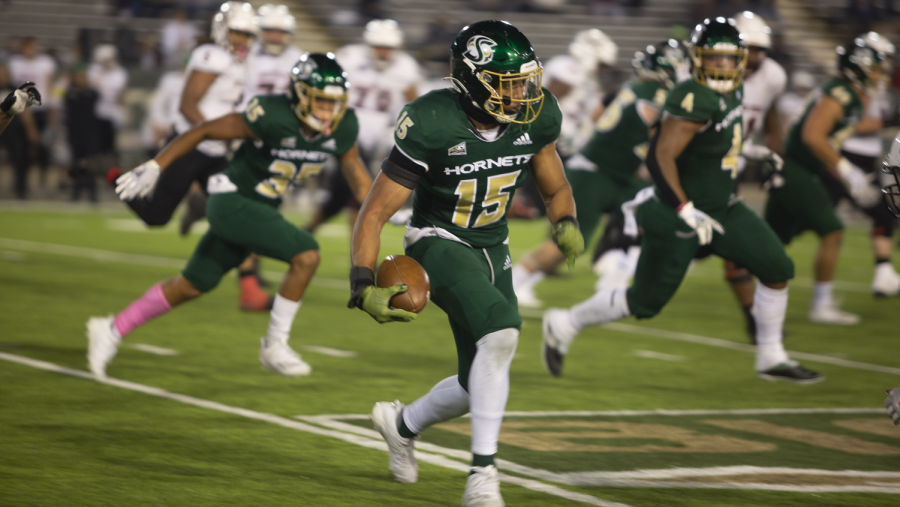 Sac State sophomore nickelback Marte Mapu (15) intercepts the ball from Southern Utah quarterback Justin Miller on Oct. 9, 2021, at Hornet Stadium. The Hornets beat the Montana Grizzlies 28-21 on Saturday Oct. 16, 2021 at Washington-Grizzly Stadium.