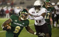 Hornet sophomore running back Marcus Fulcher (9) sheds off a tackle from Southern Utah's redshirt junior cornerback Alonzo Davis (17) for a first down on Saturday, Oct. 9, 2021, at Hornet Stadium. The Hornets crushed the Southern Utah Thunderbirds 41-20.