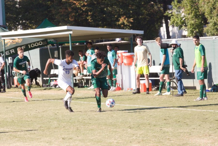 Sac State sophomore forward Titus Washington races past a CSU Bakersfield defender on Wednesday, Oct.13, 2021, at Hornet Field. Washington has one goal and three assists so far this year.