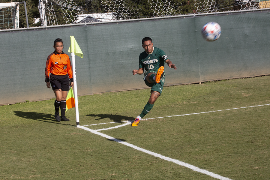 Sacramento State men's soccer junior midfielder Oscar Govea hits a corner kick against CSU Bakersfield on Oct.13, 2021, at Hornet Field in a 2-0 loss.The Hornets currently  average 1.06 goals a match.