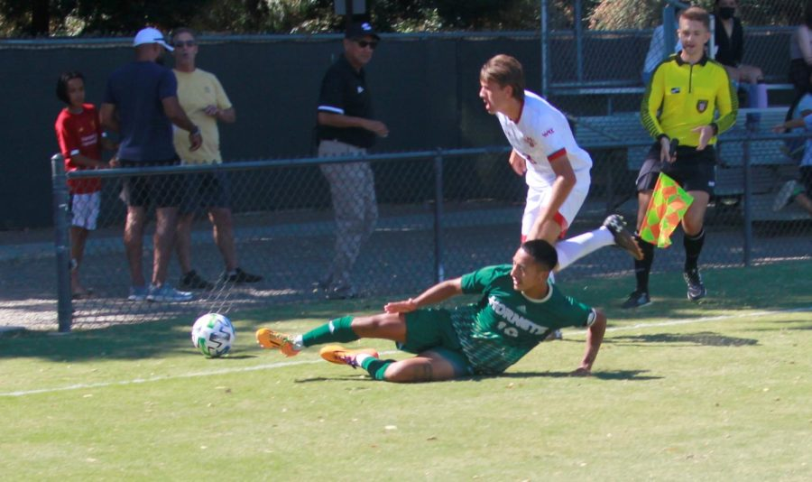Hornet junior midfielder Oscar Govea is tripped up as the ball goes out of play on Sunday, Sept. 19, 2021, against Saint Marys in a 1-0 loss for the Hornets. The Hornets have averaged just 1.25 goals on the year.