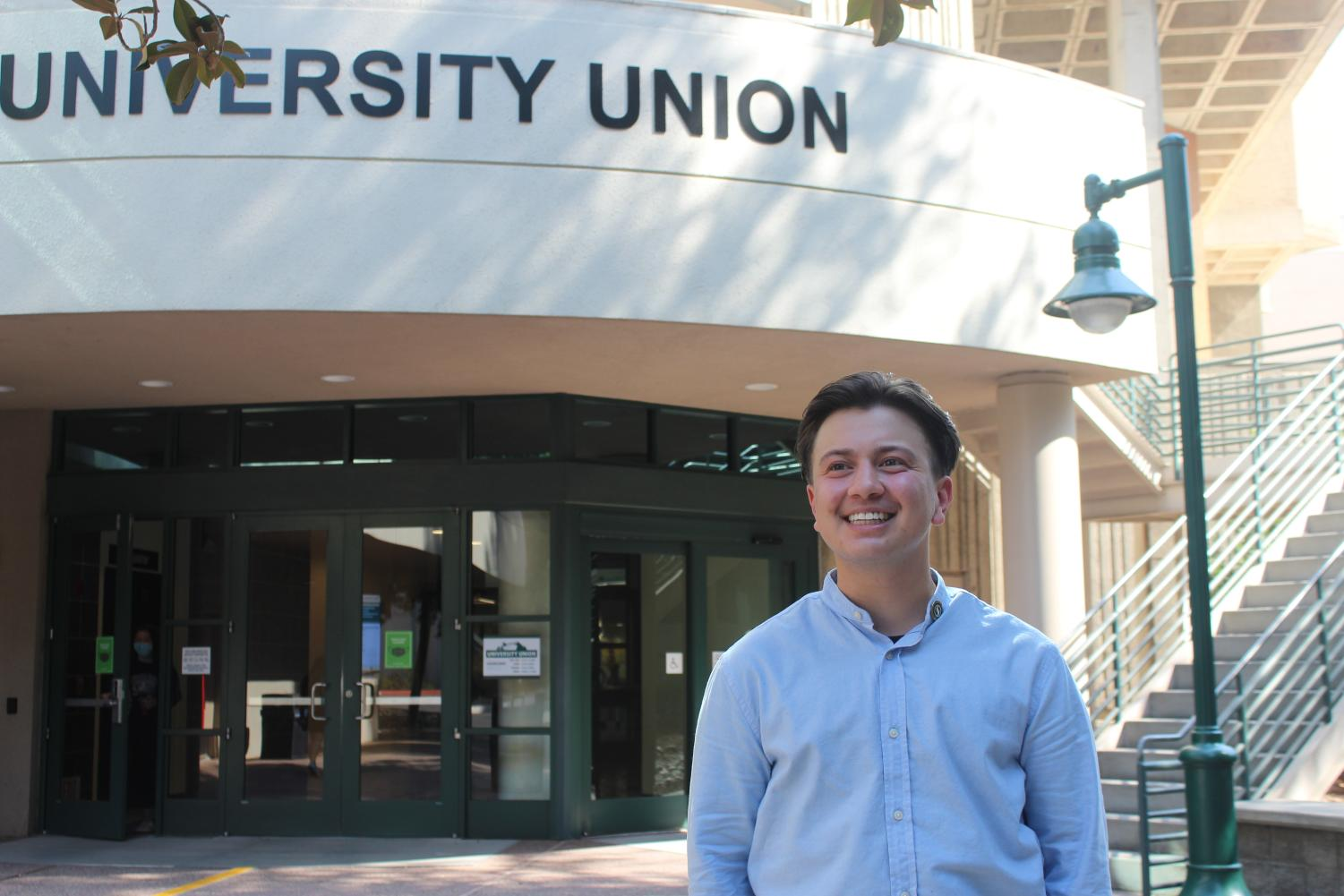 25-year-old Ezra Cabrera, standing in front of the University Union building on September 21, 2021. Cabrera is a second year Master's student at Sac State and plans to continue advocating for the LGBTQ+ community.